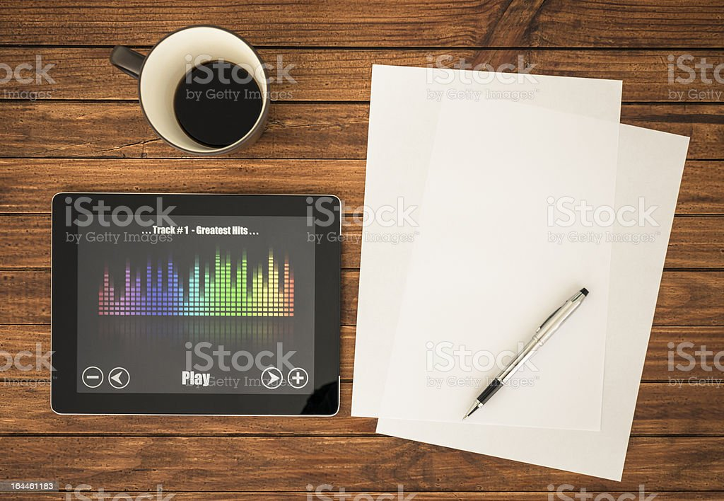 Desk with mp3 music player on digital tablet royalty-free stock photo