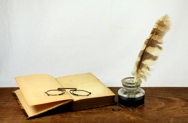 desk with old books, pince-nez and inkwell - ink well stock photos and pictures