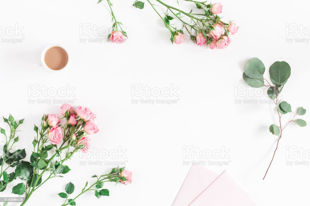 desk with rose flowers eucalyptus branch pink paper blank picture id924396428