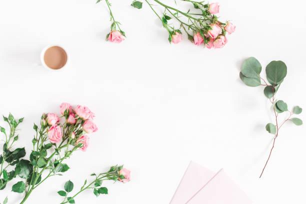desk with rose flowers, eucalyptus branch, pink paper blank - folha de caderno imagens e fotografias de stock