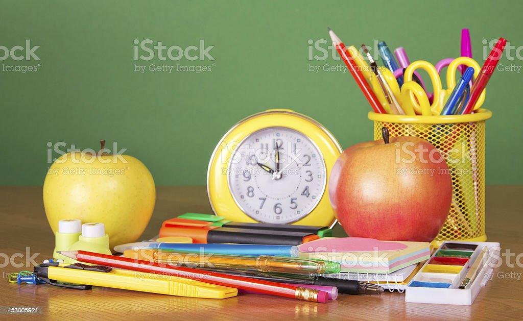 Desk with school stuff stock photo