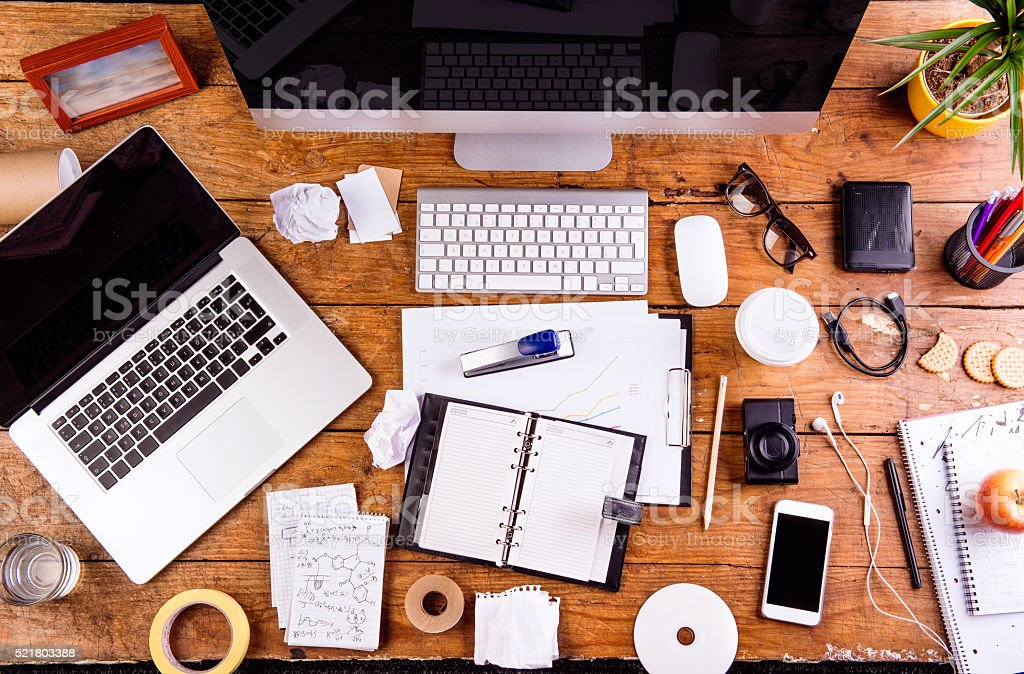 Desk with various gadgets and office supplies. Flat lay stock photo