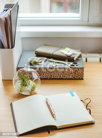 Desk with various stationery objects. Concept for writing in a diary or working in general.