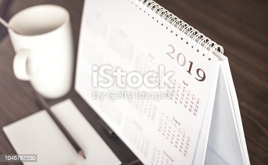 Desktop calendar sitting on desk showing year of 2019
