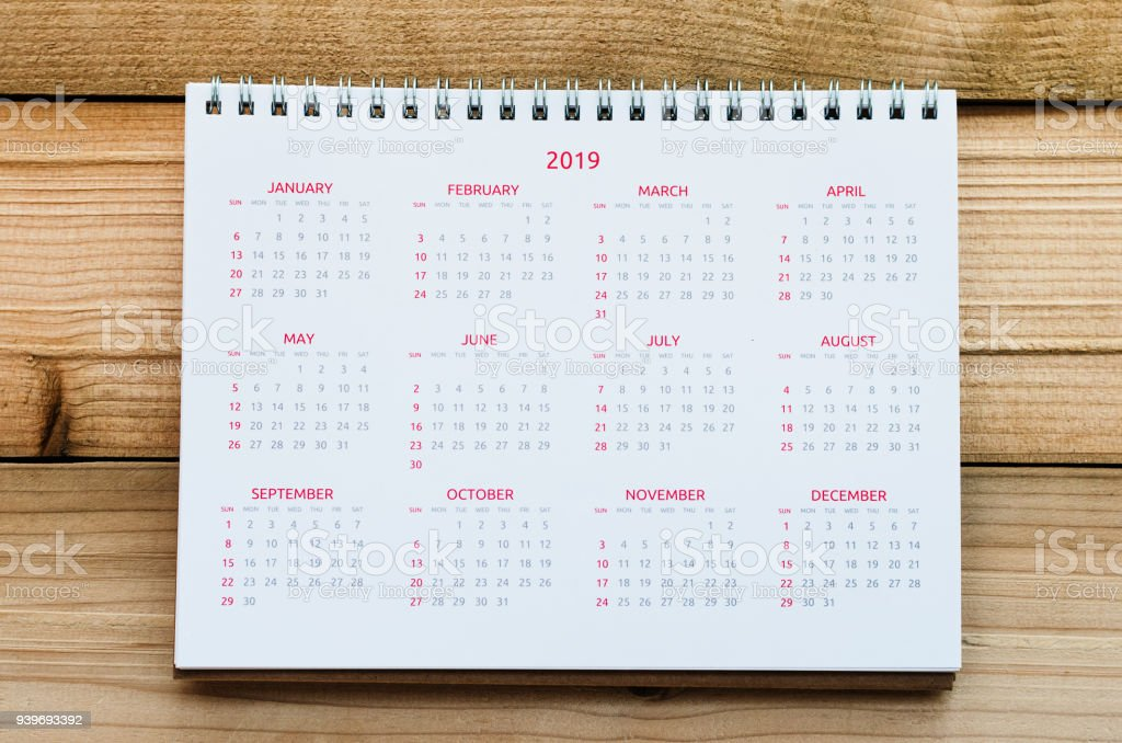 Desktop Calendar 2019 with 12 month on wood board or wood table. stock photo