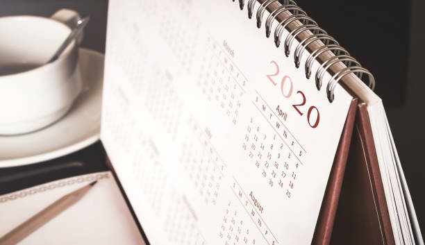 Desktop calendar 2020 Desktop calendar sitting on desk showing year of 2020 modern period stock pictures, royalty-free photos & images