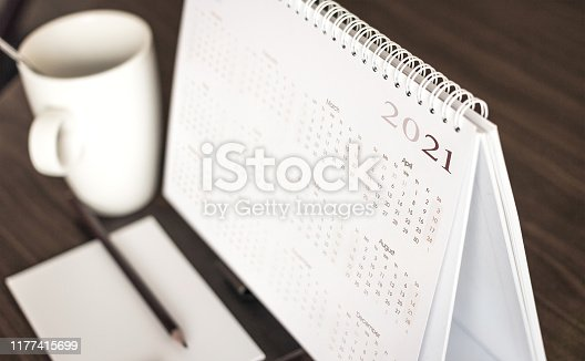 Desktop calendar sitting on desk showing year of 2021