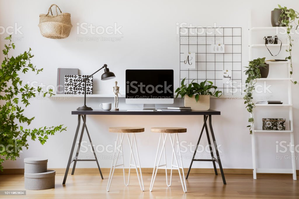Desktop computer mock-up on an industrial desk in a scandinavian student bedroom interior workspace with white walls – zdjęcie