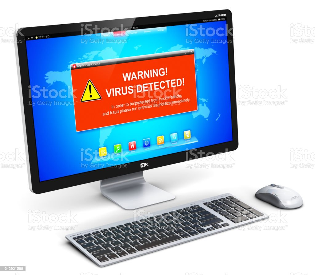 Desktop computer PC with virus attack warning message on screen stock photo
