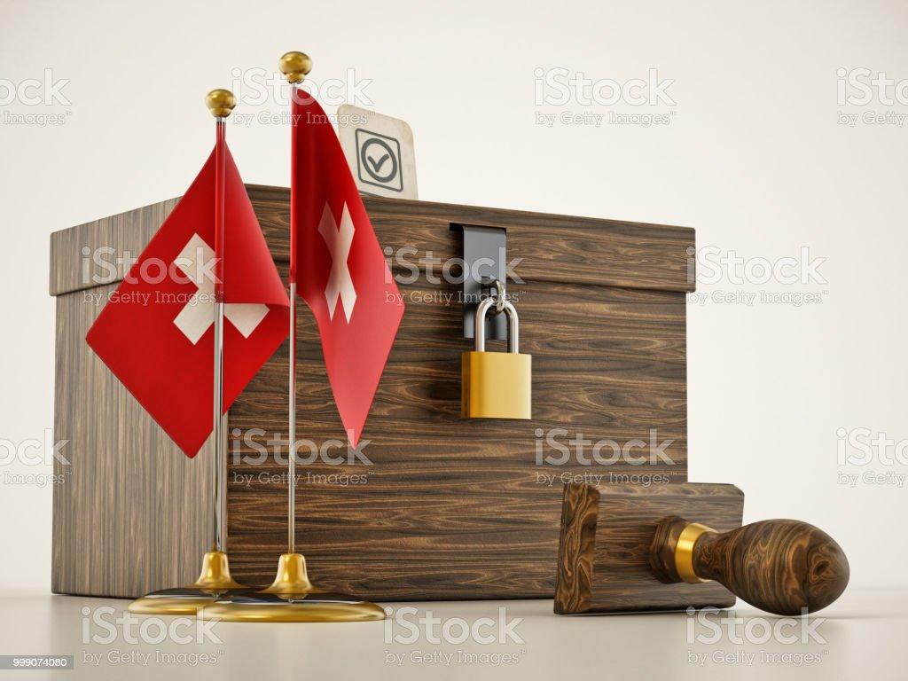 Desktop-Flaggen der Schweiz und Stempel stehen neben der Urne – Foto