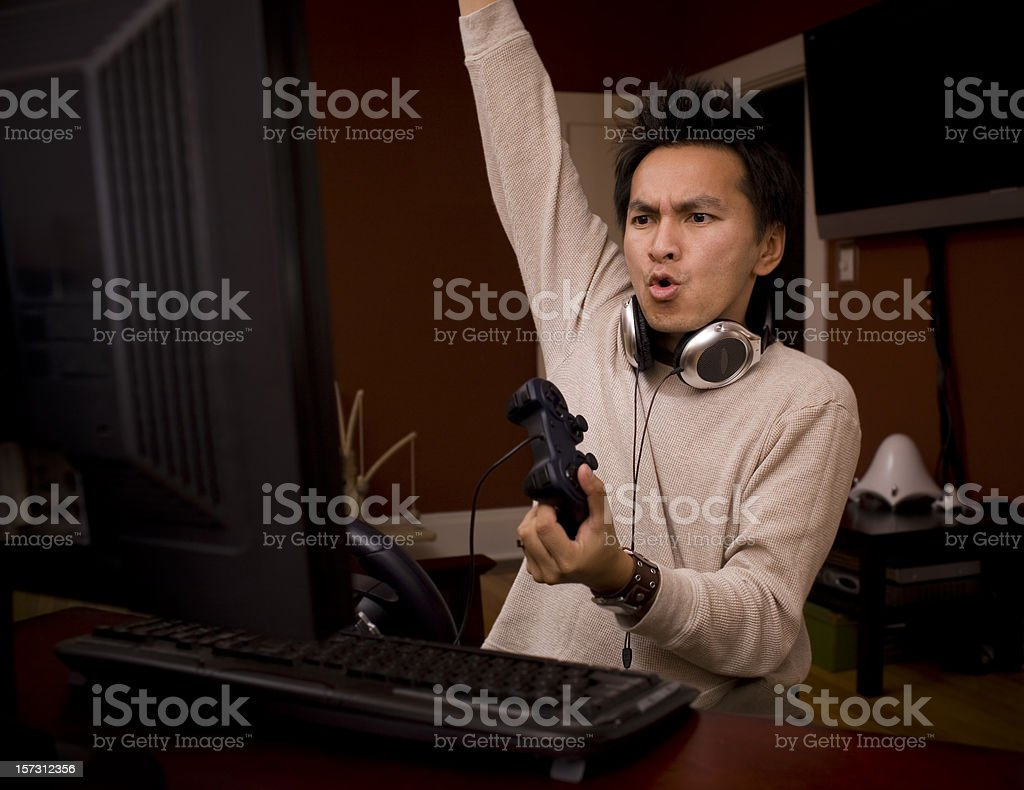 Desktop Gamer Pumping Fist in Air, Excited About Winning, Copyspace stock photo