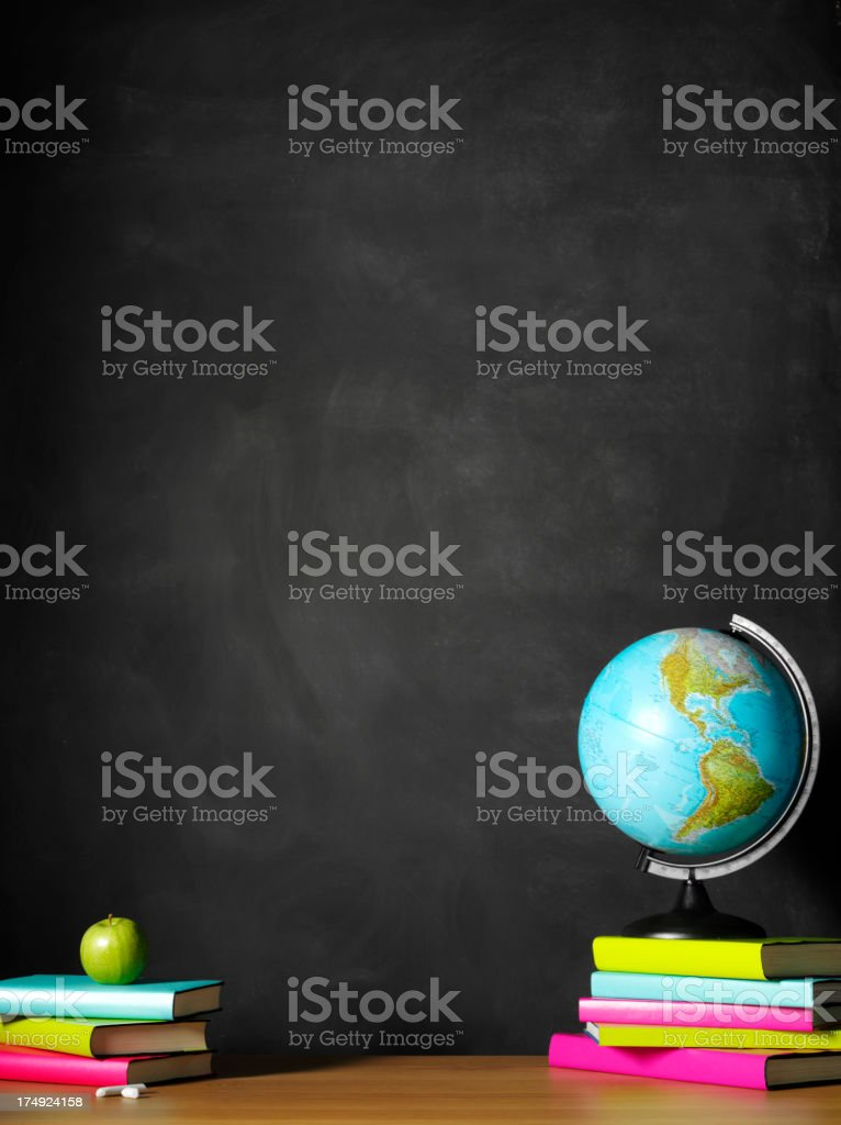 Desktop Globe with Books on the Teacher's School Desk royalty-free stock photo
