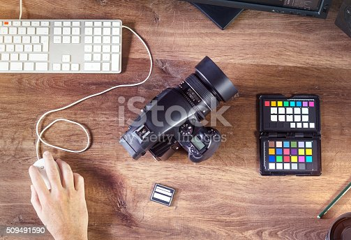 istock Desktop shot of a modern Digital Photo Camera with Laptop 509491590