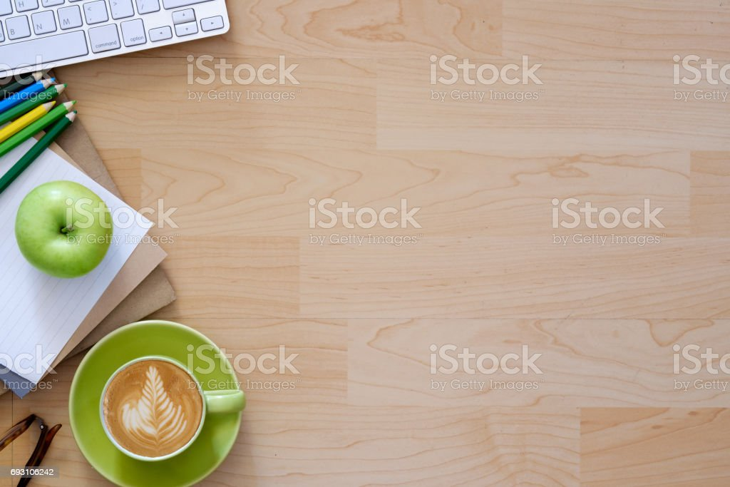 Desktop with business objects and snack foods. stock photo