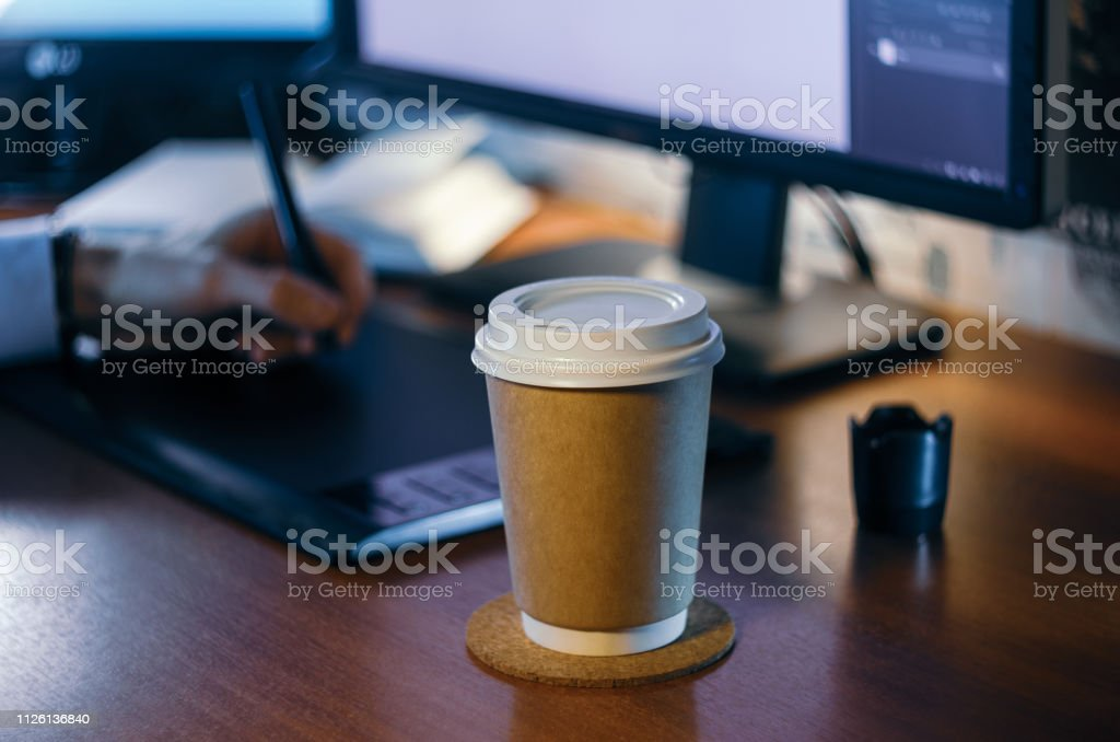 Desktop side view. Computer Graphics Tablet Diary Cup of coffee Hand....