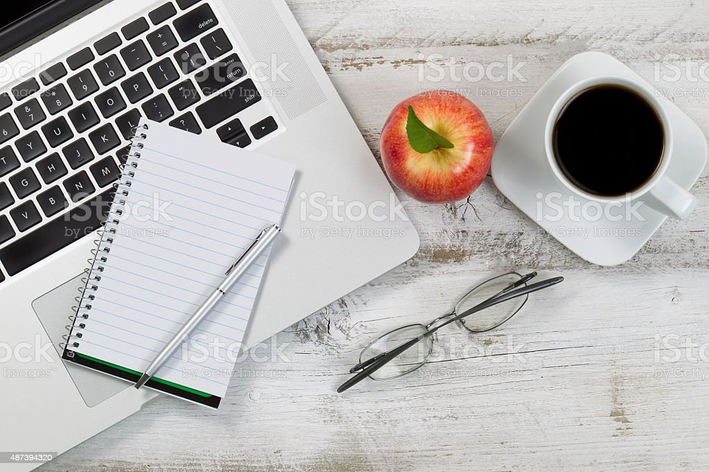 Desktop with computer with food and drink for snacks stock photo