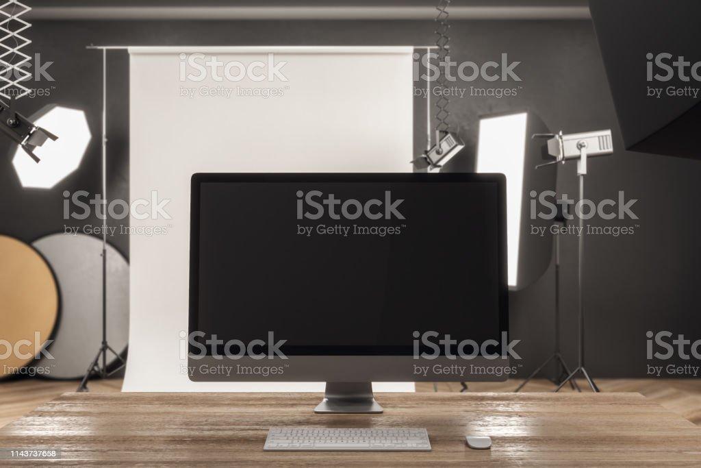 Close up of modern designer desktop with empty computer screen in...