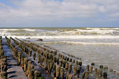Desolate Breakwater At The Seaside Stock Photo - Download Image Now