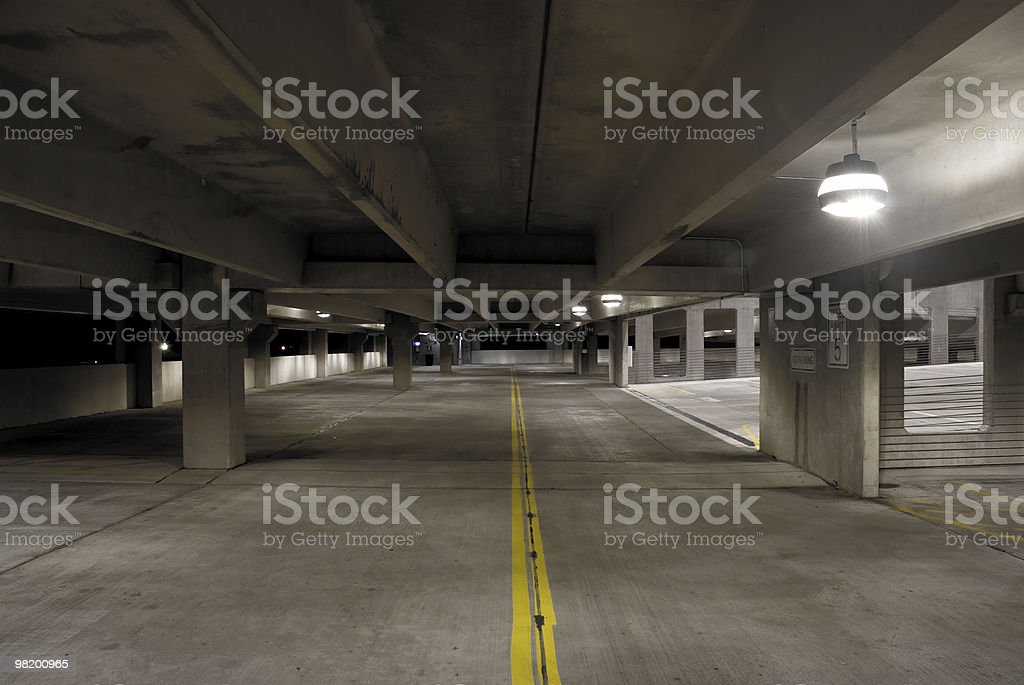 Desolate, Empty Parking Garage at Night royalty-free stock photo