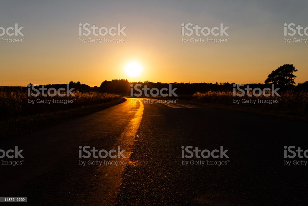 Desolate road at sunset stock photo