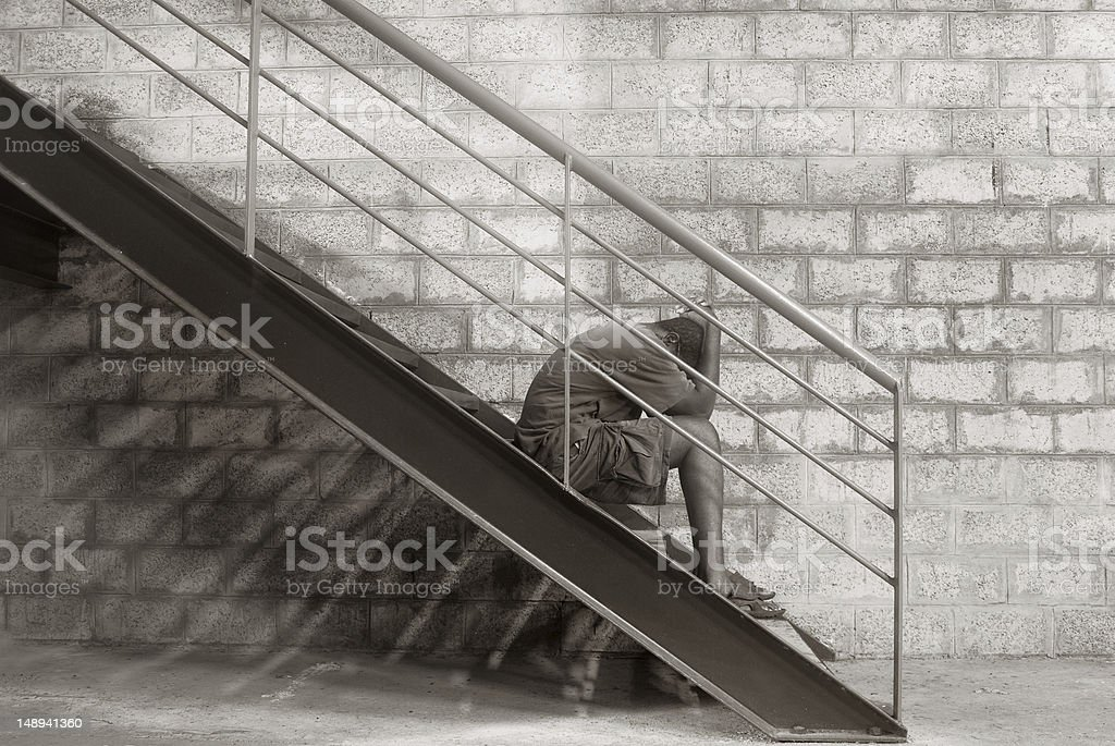 despair; man sitting with hands on head stock photo