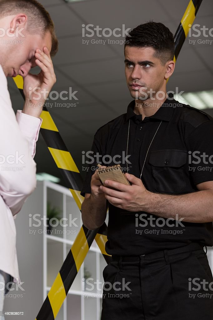 Despair man talking with policeman stock photo