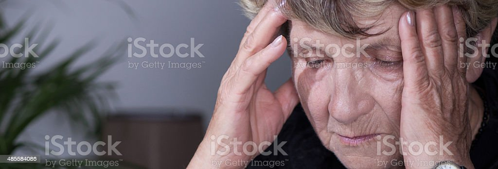 Despair senior woman stock photo