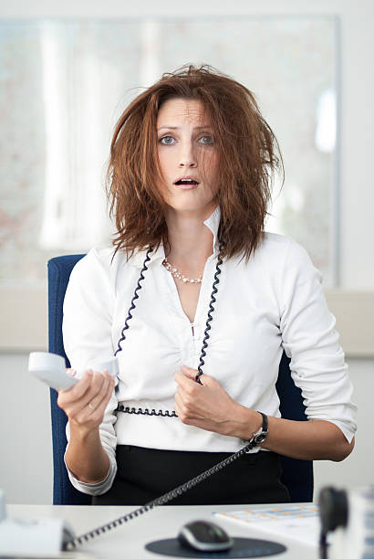 despaired businesswoman - messy hair stock photos and pictures