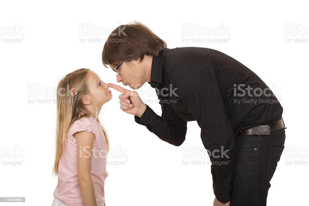 Despairing father pointing finger at his daughter royalty-free stock photo