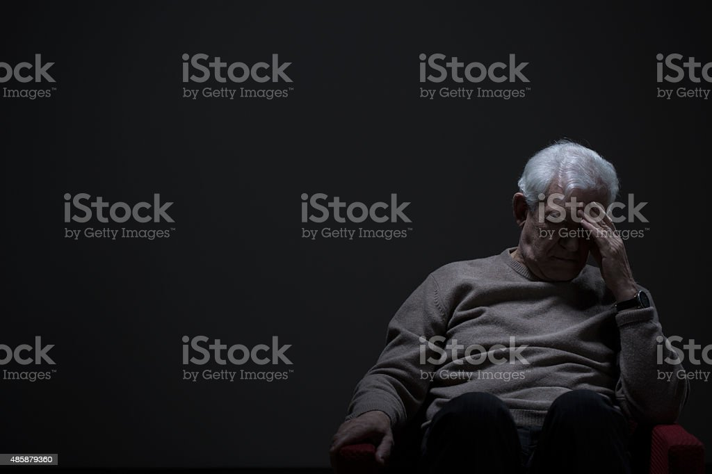 Despairing senior man stock photo