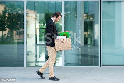 1181817161 istock photo Desperate and fired businessman walking away from office 803721016
