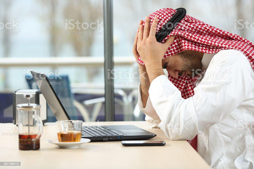 Desperate arab saudi man online bankruptcy stock photo