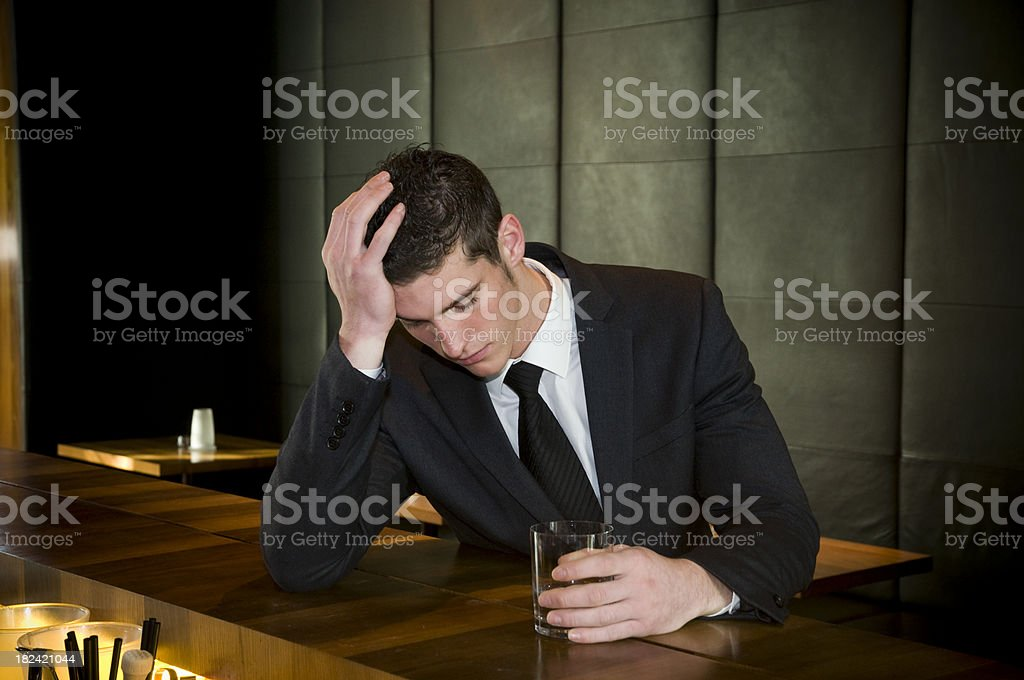 desperate businessman in bar royalty-free stock photo