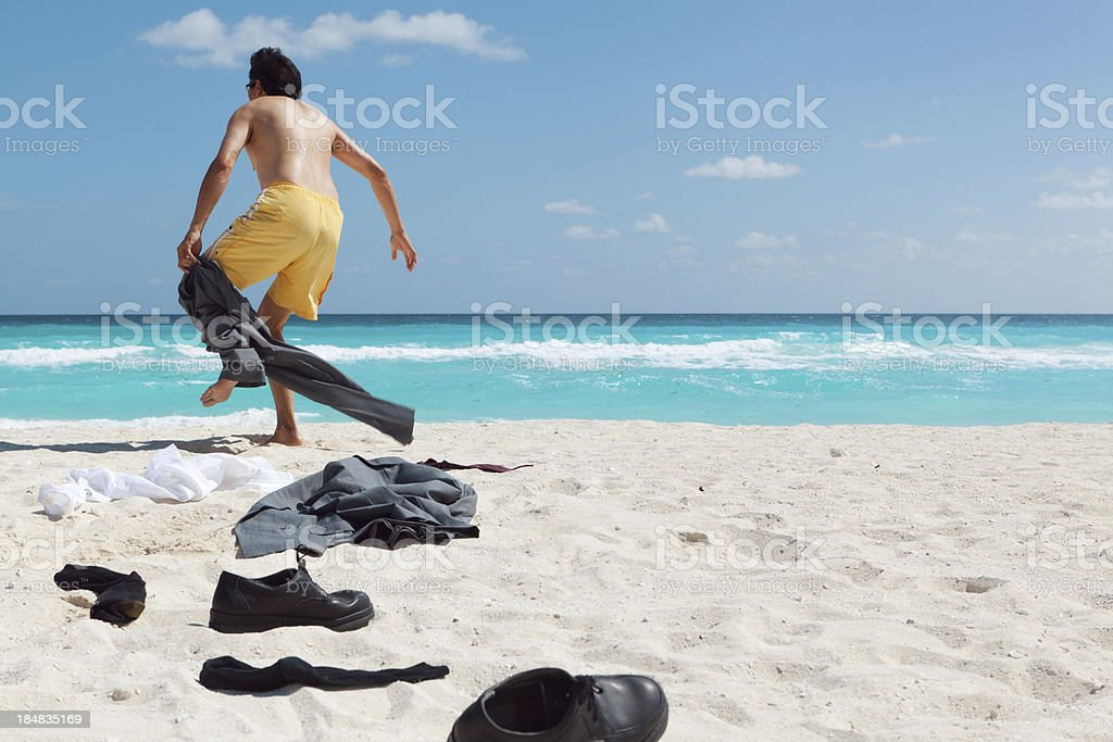 Desperate Businessman Needing a Vacation in Caribbean Beach Hz royalty-free stock photo