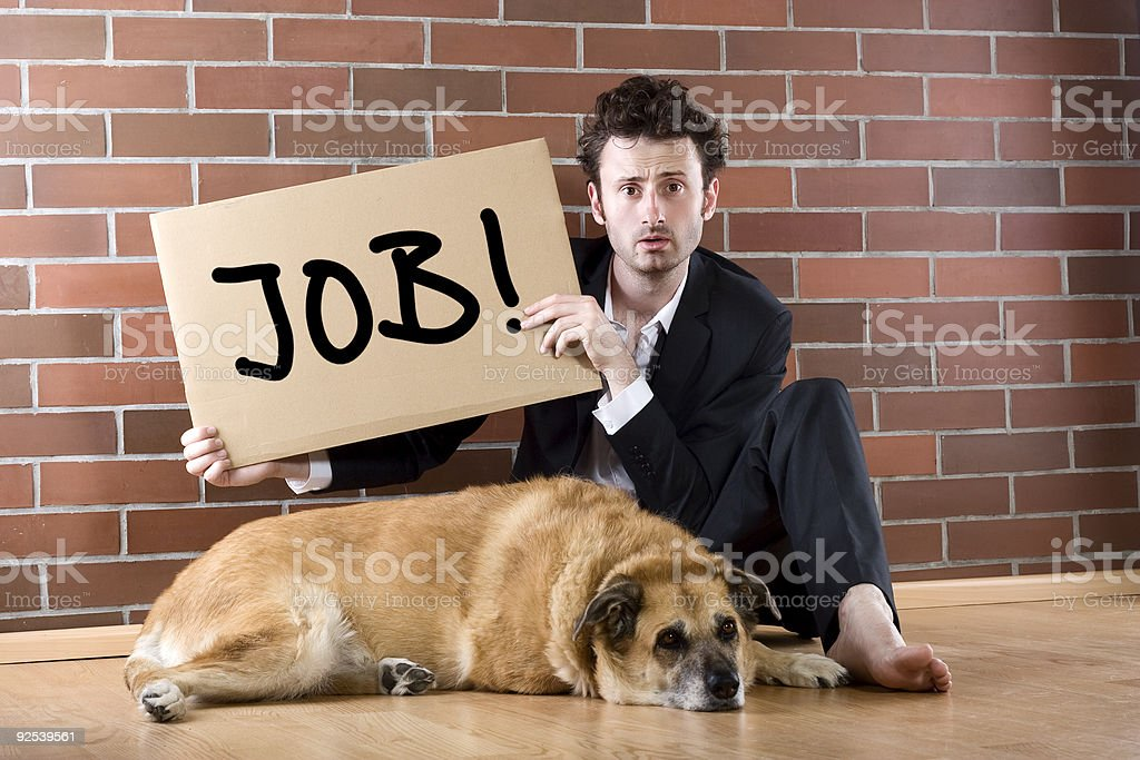 "desperate businessman pleads with sign ""Need Job"" royalty-free stock photo"
