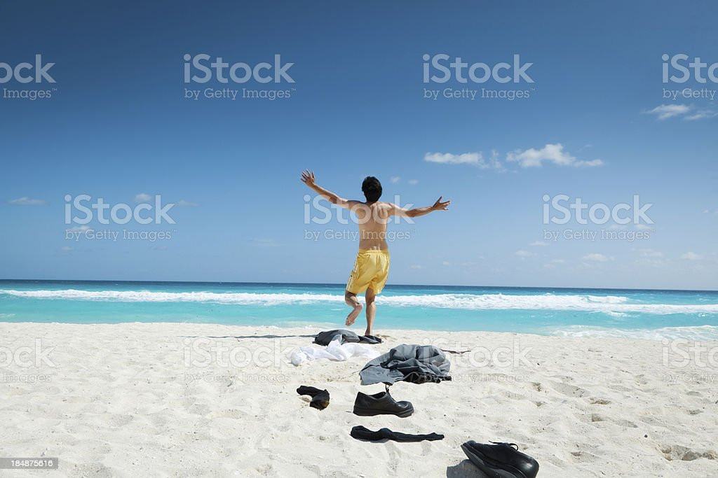 Desperate Businessman Vacationing in Caribbean Beach Hz royalty-free stock photo