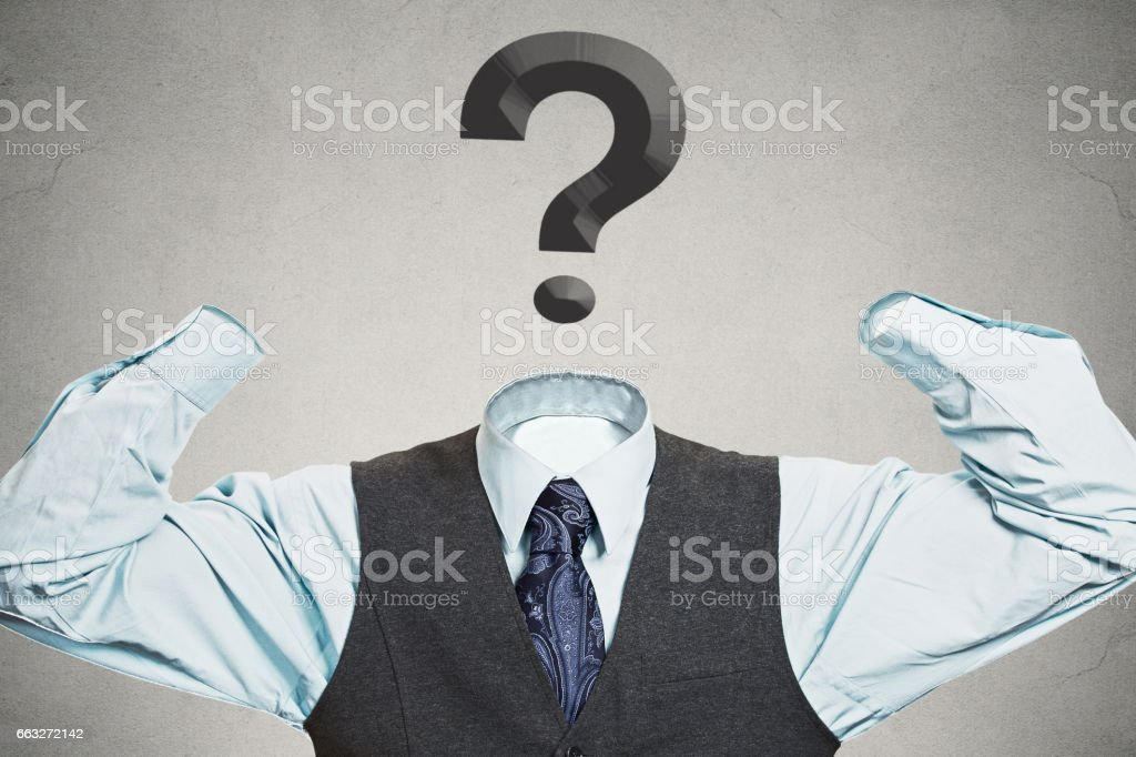 Desperate businessman with question mark instead of head stock photo