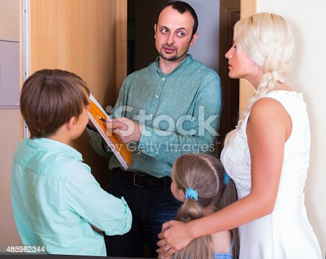 istock Desperate family and irritated inspector 485962344