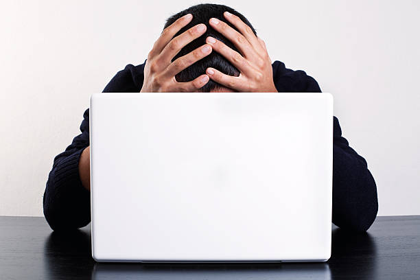 desperate for work desperateness in front of the laptop face down stock pictures, royalty-free photos & images
