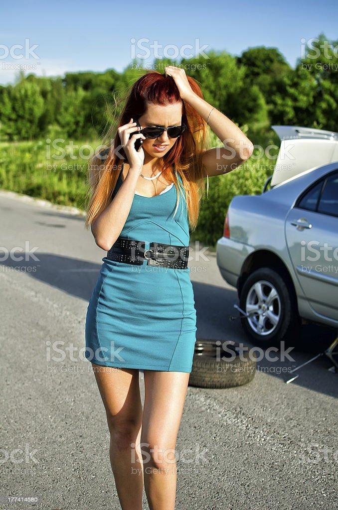 Desperate girl calling to car repair service royalty-free stock photo