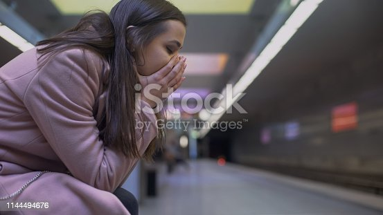 istock Desperate lady suffering anxiety attack at subway station, feeling helpless 1144494676