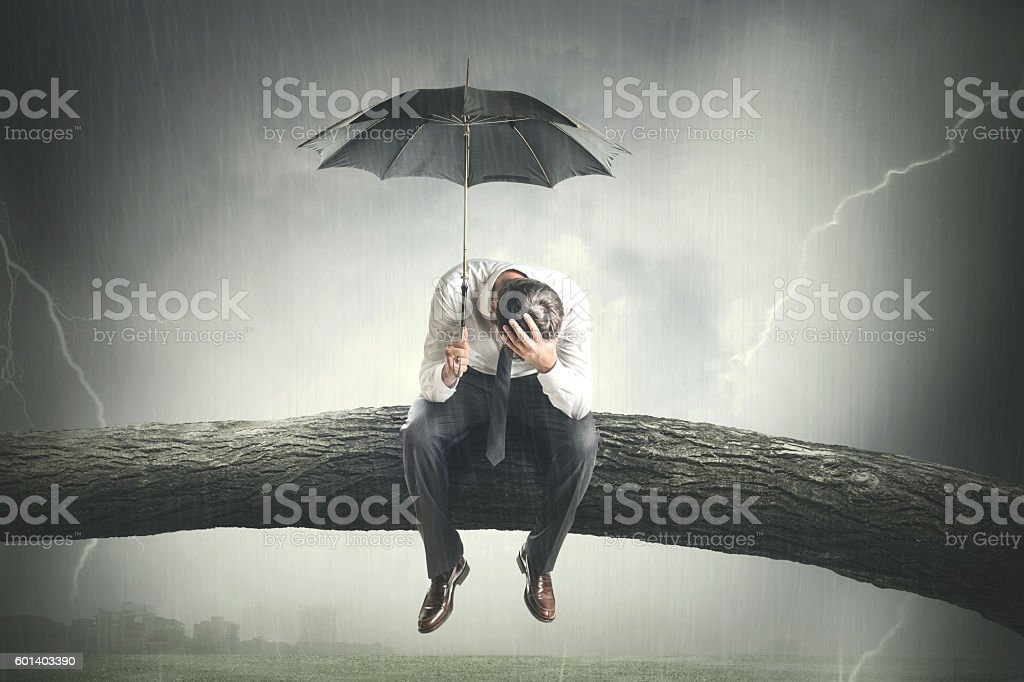 desperate man crying under rain - foto stock