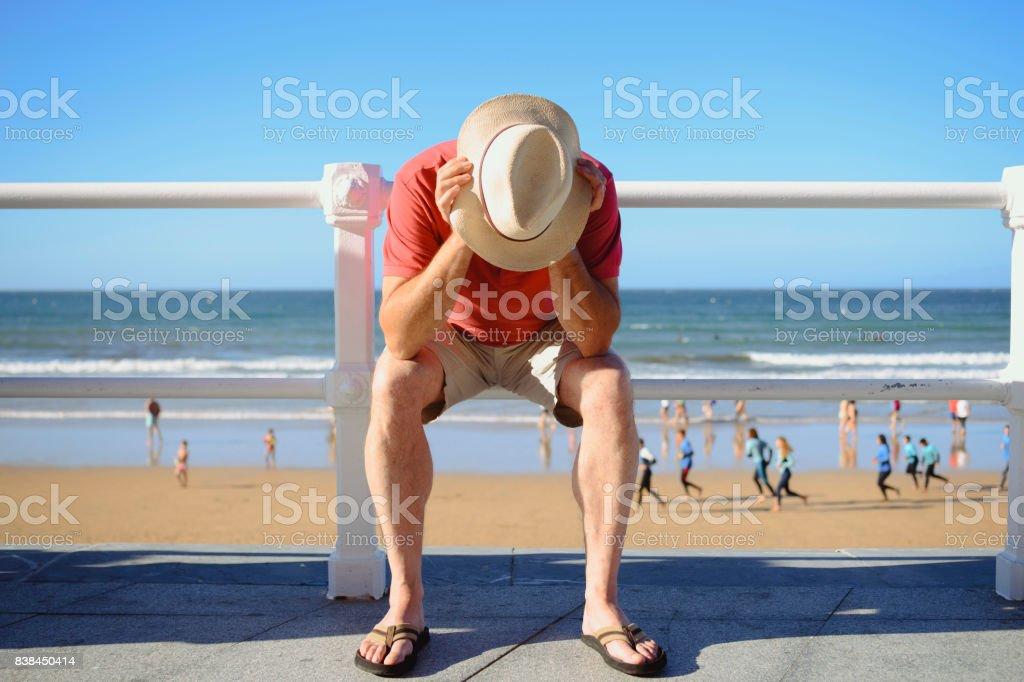 Desperate man on the promenade stock photo