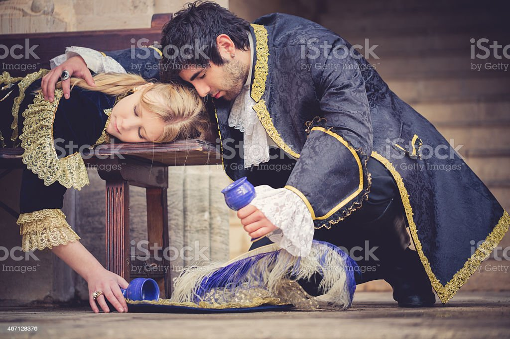 desperate romeo with juliet drinking the poison stock photo