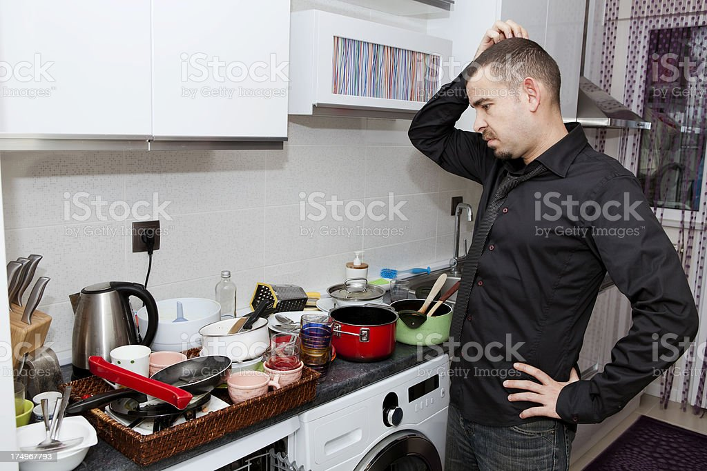 desperate single man in kitchen stock photo