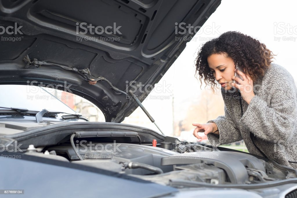 Desperate woman calling emergency help smartphone stock photo