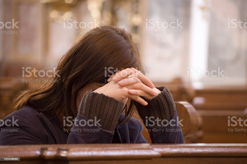 Desperate Woman in Church royalty-free stock photo