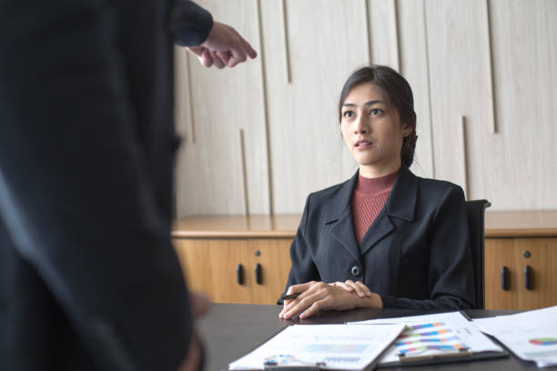 Desperate young Asian Woman unable to work with stress situation, suffering stress, boss come to Fired her from Job, Woman in Stress situation Concept. stock photo