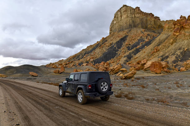 Despite increase in outdoor tourism and recreation, many roads in the western U.S. are still unpaved and require four wheel drive vehicles such as the Jeep pictured. Despite increase in outdoor tourism and recreation, many roads in the western U.S. are still unpaved and require four wheel drive vehicles such as the Jeep pictured. despite stock pictures, royalty-free photos & images