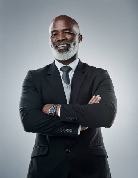 Despite what you believe, your potential to succeed is limitless Studio portrait of a mature businessman against a grey background despite stock pictures, royalty-free photos & images
